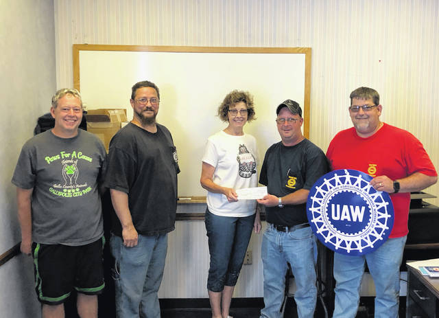 Pictured are John Bond, union member, Mike Broyles, local union first vice-president, Chris Myers Cozza, SNAP president and founder, Mike Miller, local union president, and Rick Rardin, local union second vice-president.