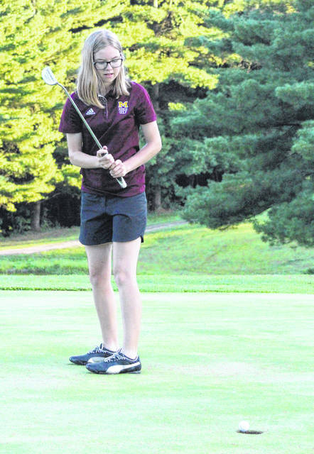 Meigs junior Caitlin Cotterill watches putt go in on the sixth hole during Thursday night's dual golf match with Vinton County at Meigs Golf Course in Pomeroy, Ohio.