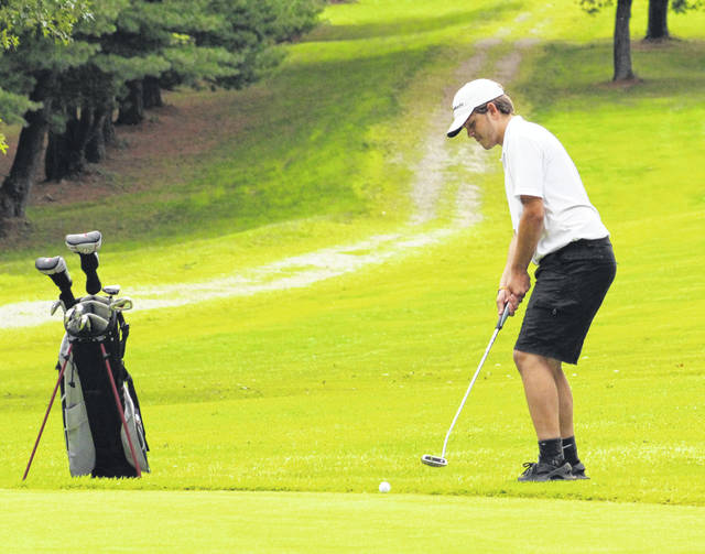 River Valley junior Joel Horner hits a putt attempt at the sixth hole of Tuesday night's TVC Ohio golf match at Meigs Golf Course in Pomeroy, Ohio.