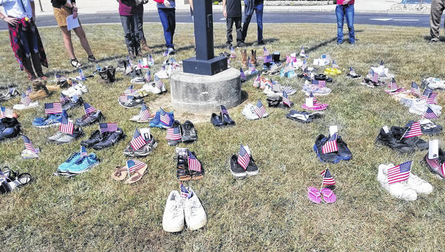 River Valley High School students circle shoes outside of the school Wednesday in remembrance of the Sept. 11 World Trade Center victims.