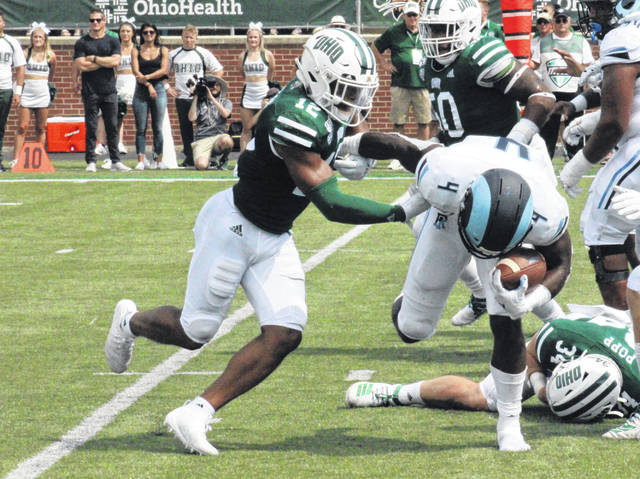 Ohio redshirt junior Jarren Hampton (12) tackles a URI ball carrier, during the Bobcats' season-opening win on Aug. 31 in Athens, Ohio.