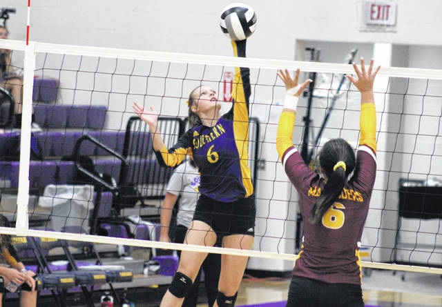 Southern senior Phoenix Cleland (left) attempts a spike over Meigs senior Maci Hood (right), during the Lady Tornadoes non-conference victory on Monday in Racine, Ohio.