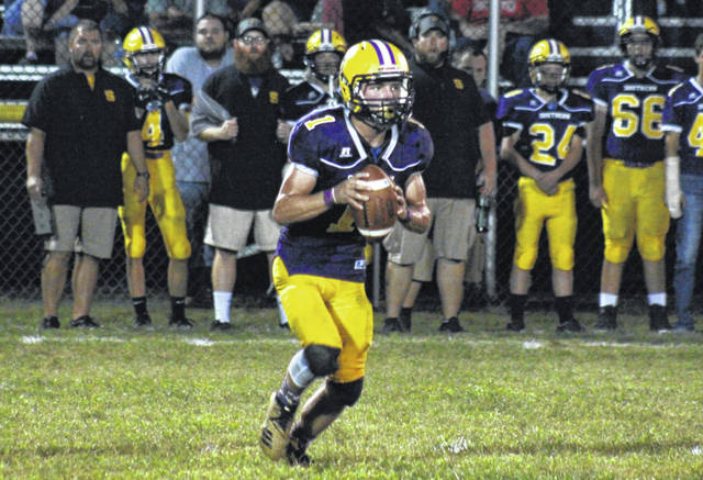 Southern senior Gage Shuler (1) rolls out of the pocket, during the Tornadoes' 58-22 victory over Wahama on Sept. 13 in Racine, Ohio.