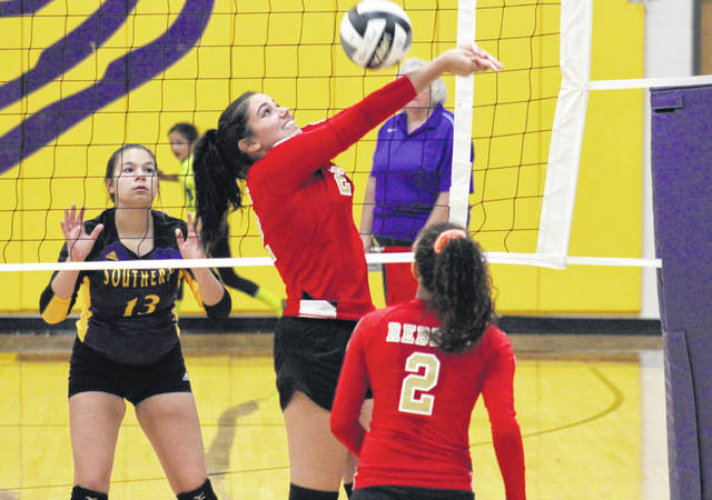 SGHS senior Olivia Johnson (center) sends the ball over the net in between South Gallia's Amaya Howell (2) and Southern's Cassidy Roderus (13), during the Lady Tornadoes' 3-0 victory on Monday in Racine, Ohio.