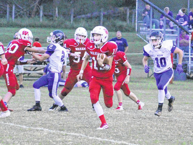 Wahama senior Brayden Davenport (11) runs for yardage during a Week 2 TVC Hocking football contest against Miller at Bachtel Stadium in Mason, W.Va.