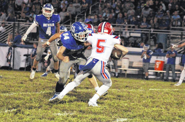 Gallia Academy sophomore Brayden Easton (64) sacks Portsmouth quarterback Drew Roe (6), during the Blue Devils' 45-28 victory on Friday in Gallipolis, Ohio.