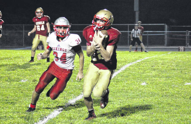 South Gallia senior Justin Butler (22) makes a reception in the fourth quarter of the Rebels' two-point setback on Saturday in Mercerville, Ohio.
