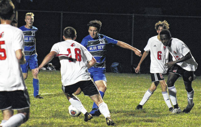 Gallia Academy sophomore Brody Wilt (26) sets up his goal-scoring shot with 41 seconds left in the first half of Tuesday's non-conference match at Lester Field in Centenary, Ohio.