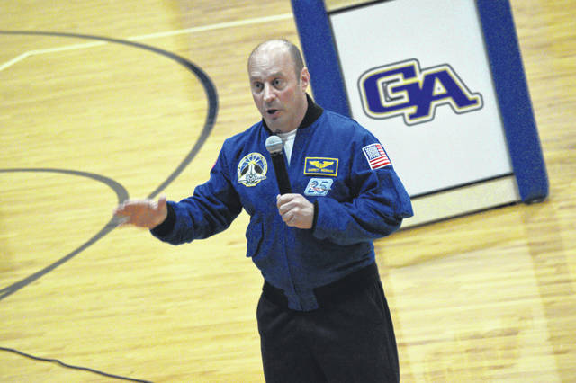 Past astronaut Dr. Garrett Reisman addresses visitors at Gallia Academy High School about the importance of perseverance.