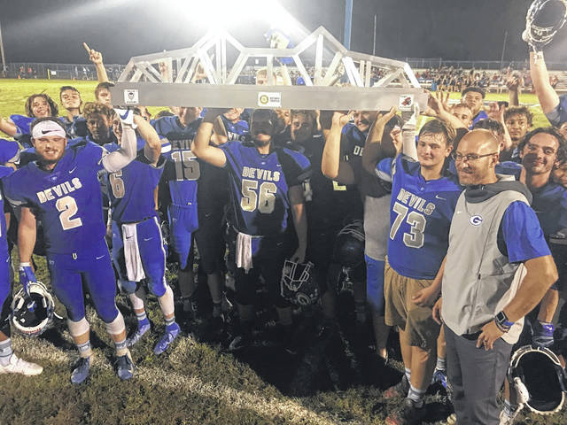 """The Gallia Academy Blue Devils football team took home more than a victory on Friday night after defeating the Point Pleasant High School Big Blacks, 14-13 at Memorial Field. The Blue Devils were presented the newly constructed Rotary trophy in a game dubbed the Battle of the Bridge. The trophy, commissioned by Pleasant Valley Hospital and donated to both the Point Pleasant and Gallipolis Rotary clubs, is constructed to resemble the Silver Memorial Bridge and will rest at Gallia Academy, until the next """"Battle."""" More on the game inside this edition and online at www.mydailytribune.com."""