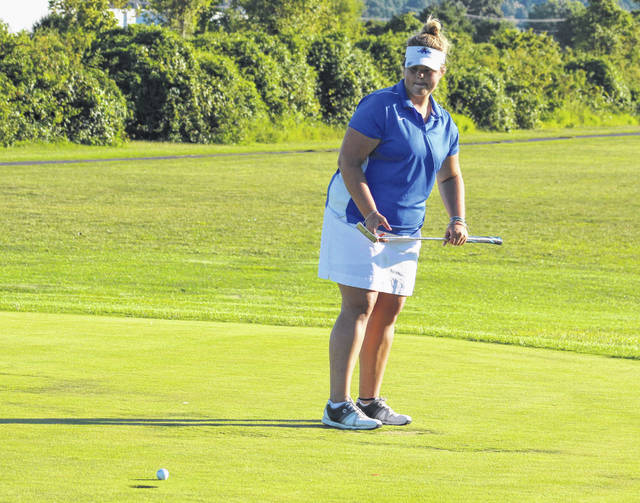 Gallia Academy junior Lilly Rees watches a putt attempt during a Sept. 5 match held at Cliffside Golf Course in Gallipolis, Ohio.