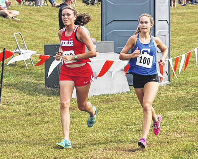 Gallia Academy junior Sarah Watts, right, keeps pace with an opponent during the varsity girls race Saturday at the 2019 Patty Forgey Invitational held in Rio Grande, Ohio.