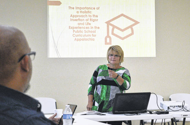 Retired Gallia County Local Schools District teacher Cindy Graham addresses area educators, Field of Hope representatives, Rio Grande Community College and University of Rio Grande officials along with state officials about the importance of collaborative approaches to education and tailoring it to Appalachian needs.
