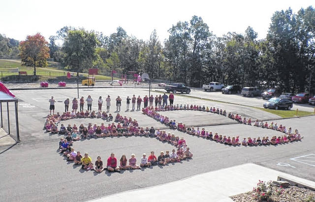 "Students and staff from Hannan Trace Elementary showed support this week for the late Alex Miller from Roane County (W.Va.) High School, a football player for the school who passed away. Miller, who wore number 80 on the field, was remembered by schools across the area in both West Virginia and Ohio, with several participating in a ""maroon out."" Hannan Trace students and staff are pictured creating ""80"" to celebrate Miller's life and show support for his family and friends."