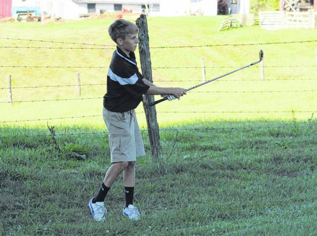 Point Pleasant freshman Joseph Milhoan watches a chip shot during an Aug. 29 match at Meigs Golf Course in Pomeroy, Ohio.