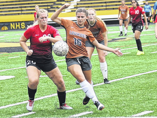Rio Grande's Amelia Bragg, left, battles Lourdes' Erin Caldwell for a loose ball during Sunday's non-conference match in Sylvania, Ohio. The Gray Wolves defeated the RedStorm, 3-1.