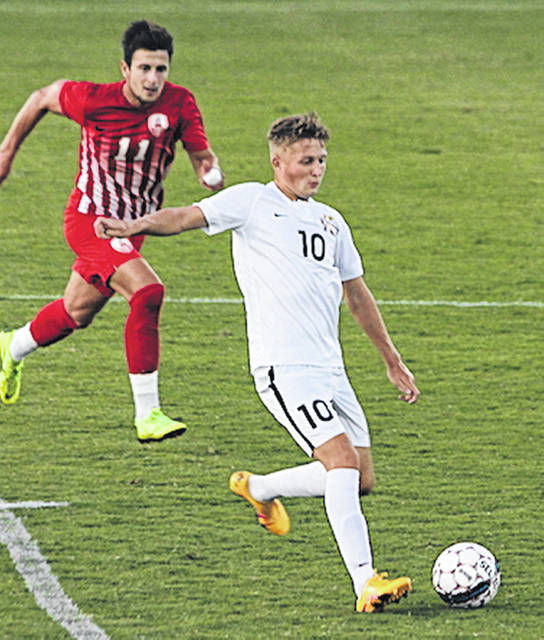 Rio Grande's Ewan McLauchlan eludes an Indiana Wesleyan defender during Saturday night's 4-2 win over the Wildcats at Evan E. Davis Field. The RedStorm improved to 6-0 with the win.