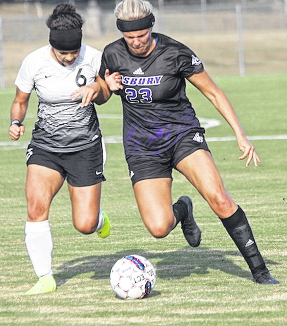 Rio Grande's Naysa Sanchez battles Asbury's Jordan Holt for control of the ball during the first half of Saturday's 2-1 loss to the Eagles at Evan E. Davis Field.