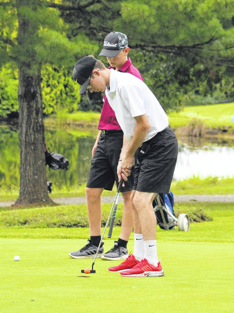 River Valley junior Blaine Cline hits a putt during an August 27 match at Meigs Golf Course in Pomeroy, Ohio.