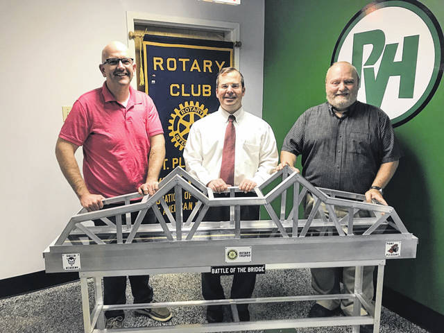 Pictured from left, Gallipolis Rotary Club President A.J. Stack, PVH CEO Jeff Noblin, Point Pleasant Rotary Club President Tim Martin, with the Battle of the Bridge Rotary traveling trophy.