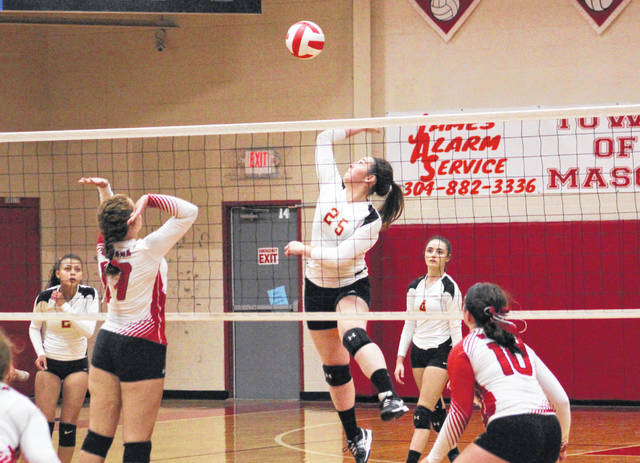 South Gallia senior Christine Griffith (25) goes up for a spike attempt during Game 2 of Tuesday night's TVC Hocking volleyball match against Wahama in Mason, W.Va.
