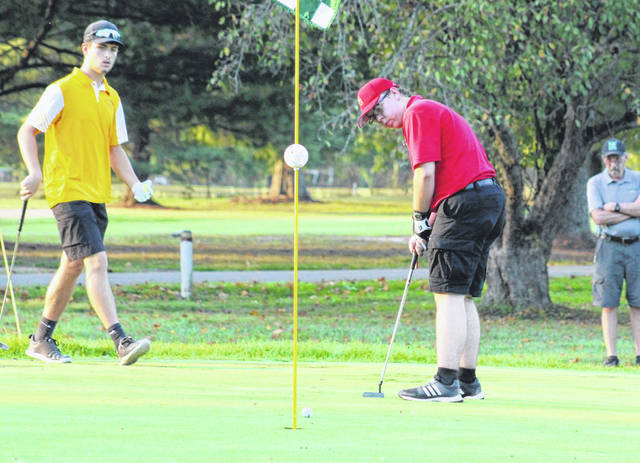 South Gallia junior Noah Spurlock hits a putt on the seventh hole during Wednesday's TVC Hocking golf match at Riverside Golf Course in Mason, W.Va.