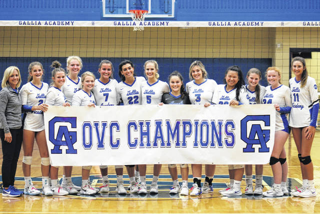 Members of the 2019 Ohio Valley Conference champion Gallia Academy volleyball team pose with the championship banner, after clinching their fifth straight OVC crown with a 3-0 sweep of Fairland on Tuesday in Centenary, Ohio.
