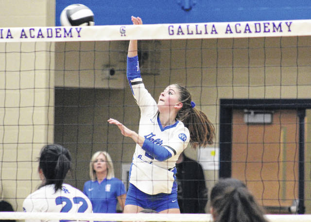 Gallia Academy sophomore Bailey Barnette spikes the ball over the net, during the Blue Angels' 3-0 win in the Division II sectional semifinal on Wednesday in Centenary, Ohio.