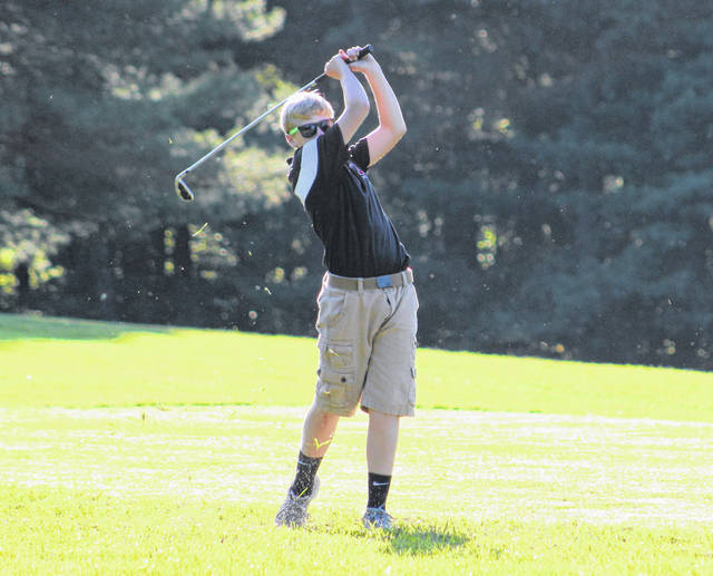 Point Pleasant freshman Joseph Milhoan watches a shot take flight during an Aug. 29 match at Meigs Golf Course in Pomeroy, Ohio.