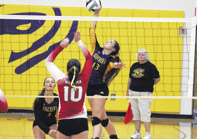 Southern sophomore Cassidy Roderus (13) attempts a spike over Wahama's Abby Pauley, in front of SHS senior Baylee Wolfe (3), during the Lady Tornadoes' 3-0 victory on Monday in Racine, Ohio.
