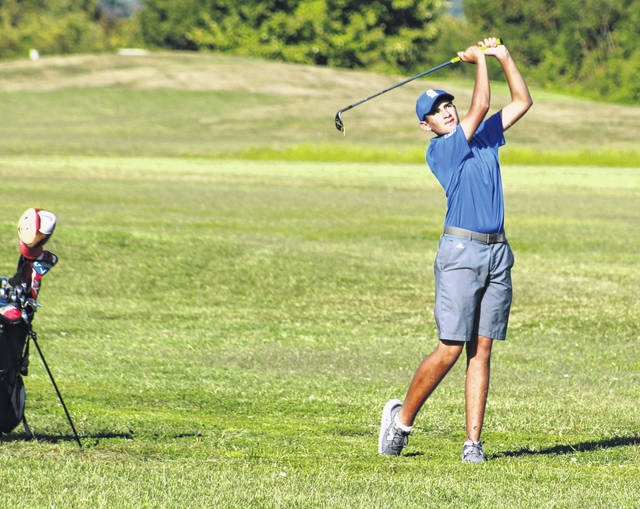 Gallia Academy freshman Laith Hamid watches a shot during a Sept. 5 round at Cliffside Golf Course in Gallipolis, Ohio.