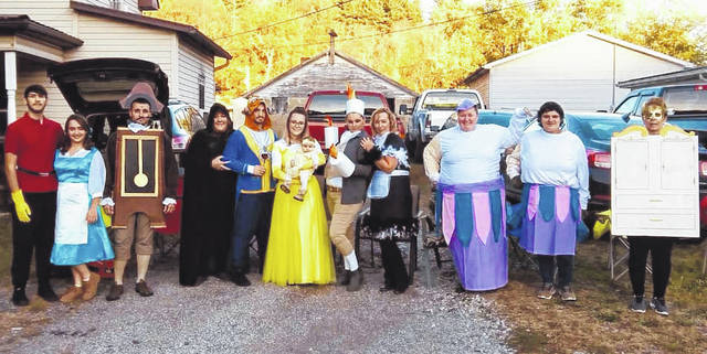 A group of family and friends dressed as characters from Beauty and the Beast to hand out candy as part of Rutland's Trick or Treat. Pictured are Gaston, Jimmy Porter; blue dress Belle, Elizabeth Fackler; Cogsworth, Jerry Lee Waters II; Sorceress, Kim Sanders; Beast, Josh Myers Thomas; yellow dress Belle, McKayla Barrett; baby Belle, Rylee Renae Waters; Lumier, Joey Waters; Babbett, Jenny Fackler; Mrs. Potts, Lacey Snedeker; Chip, Izzy Clark; and Wardrobe, Robin Haning.