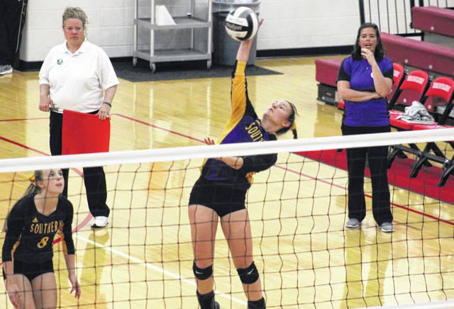 Southern senior Baylee Wolfe (center) attempts a spike beside teammate Mickenzie Ferrell (8) and in front of fourth-year SHS head coach Kim Hupp (right), during the Lady Tornadoes' 3-1 victory on Thursday in Jackson, Ohio.