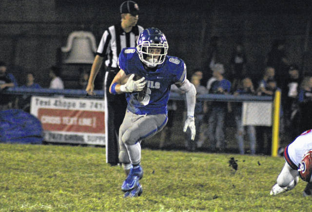 Gallia Academy senior Ryan Donovsky (6) looks for more yardage, during the Blue Devils' Week 5 win over Portsmouth in Gallipolis, Ohio.