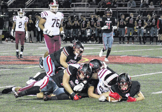 Point Pleasant sophomore Zander Watson (right) recovers a Bluefield fumble, during the Beavers' 49-14 victory on Friday in Point Pleasant, W.Va.