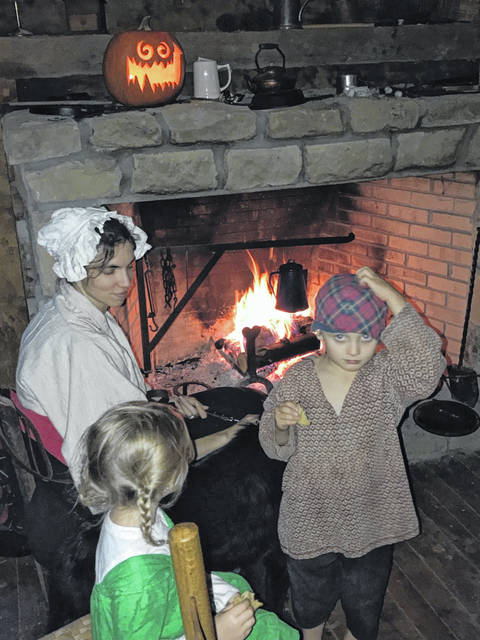 Fort Randolph's Harvest Fest and Tales in the Tavern is an event fit for the entire family, here children and adults alike dressed in colonial attire to enjoy the tales being told.