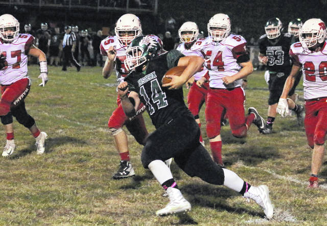 Eastern junior Steven Fitzgerald (14) breaks away from a handful of Wahama defenders during the second half of an Oct. 4 football contest at East Shade River Stadium in Tuppers Plains, Ohio.