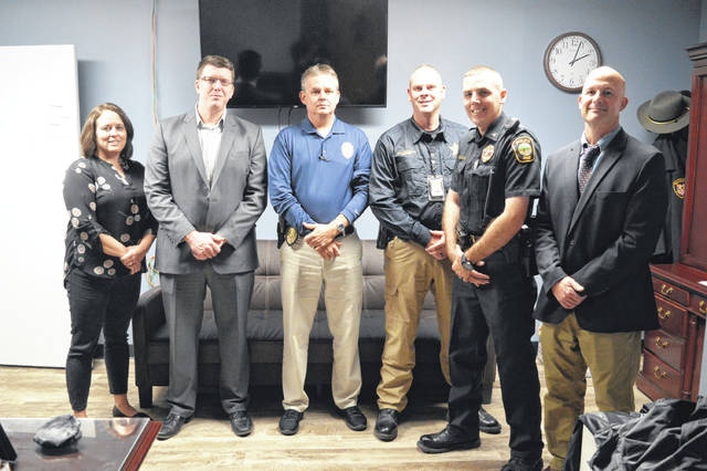 Area partners in the Gallia Handle with Care program. From left to right are Gallia Trauma Counselor Amy Sisson, Gallia Prosecutor Jason Holdren, Gallipolis Police Chief Jeff Boyer, Gallia Sheriff Matt Champlin, Rio Grande Police Chief Josh Davies and Gallipolis City Schools Superintendent Craig Wright. Not pictured, Gallia 911 Communications Director Sherry Daines, Gallia County Local Schools Superintendent Jude Meyers, Gallia Children's Services Director Russ Moore, Ohio Valley Christian School Administrator Patrick O'Donnell, Gallia Board of Developmental Disabilities Superintendent Melinda Kingery, Buckeye Hills Career Center Superintendent Jamie Nash, Ohio State Highway Patrol Gallipolis Post Commander Lt. Barry Call, Handle with Care State Contact Robyn Vannoy.