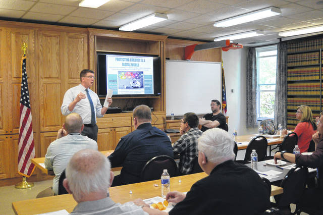 Gallia Prosecutor Jason Holdren addresses community members, educators and faith-based organizations about the children and internet safety at an earlier stakeholders meeting in late August.