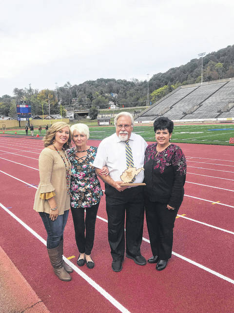 Over the weekend, Gary Stewart, pictured third from left, was inducted into the West Virginia Marching Band Directors Hall of Fame. Pictured alongside Stewart are wife Linda, as well as daughters Tiffany Preston and Melissa VanMeter.