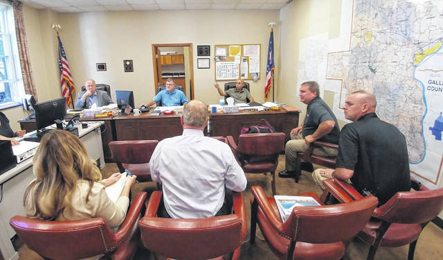 County officials meet with DLZ, a construction and consulting architecture firm, about ongoing plans for a new county jail.
