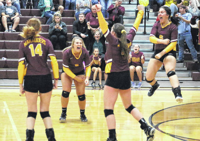 Meigs seniors Bre Zirkle, second from left, and Maci Hood, right, celebrate with teammates after clinching the final point of Game 5 Thursday night during a TVC Ohio volleyball contest against River Valley at Larry R. Morrison Gymnasium in Rocksprings, Ohio.