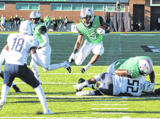 Marshall running back Sheldon Evans (5) leaps over a defender for extra yardage during the second half of Saturday's Conference USA football game against Old Dominion at Joan C. Edwards Stadium in Huntington, W.Va.