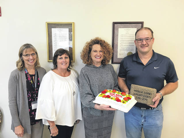 New Gallia Board of Developmental Disabilities Superintendent Melinda Kingery, Board President Lisa Harder and Board Vice President Don Pearce make a memorial paver dedication presentation to Pamela Combs at her last board meeting on September 24.