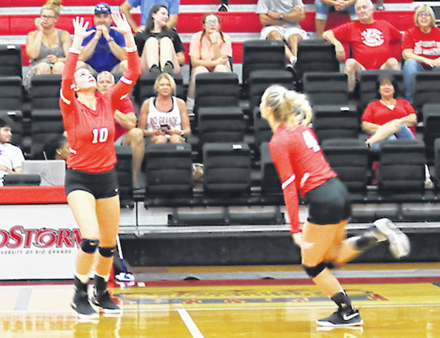 Rio Grande's Macy Roell (10) sets for teammate Baylee Pursifull (4) during Tuesday night's five-set win over West Virginia University-Tech at the Newt Oliver Arena.