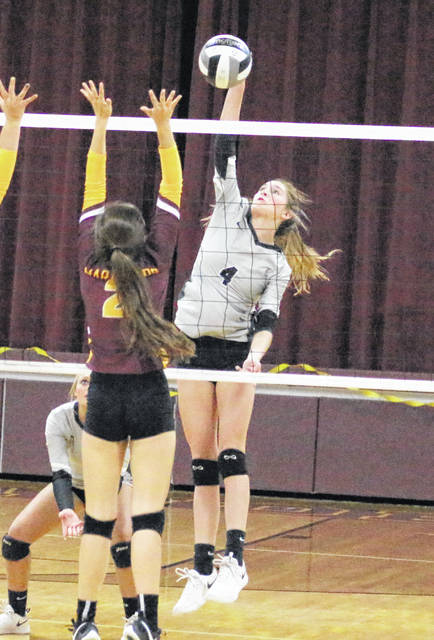 River Valley junior Mikenzi Pope (4) leaps for a spike attempt during an Oct. 10 volleyball match against Meigs in Rocksprings, Ohio.
