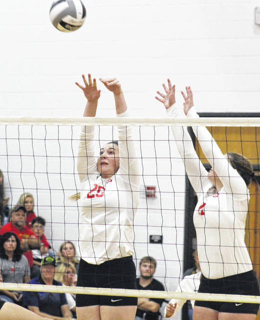 Lady Rebels Christine Griffith (25) and Jessie Rutt (right) team up for a block, during South Gallia's non-confernece match with River Valley on Aug. 26 in Mercerville, Ohio.