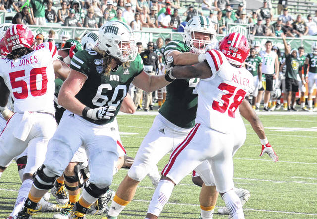 Bobcats Austen Pleasants (60) and Adam Luehrman team up to block a Louisiana defender, during a non-conference game on Sept. 21 at Peden Stadium in Athens, Ohio.