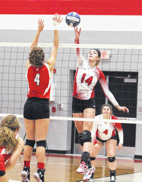 Wahama junior Emma Gibbs (14) leaps for a free ball at the net during a Class A Region IV, Section 1 volleyball contest against Ravenswood on Nov. 5 in Ravenswood, W.Va.