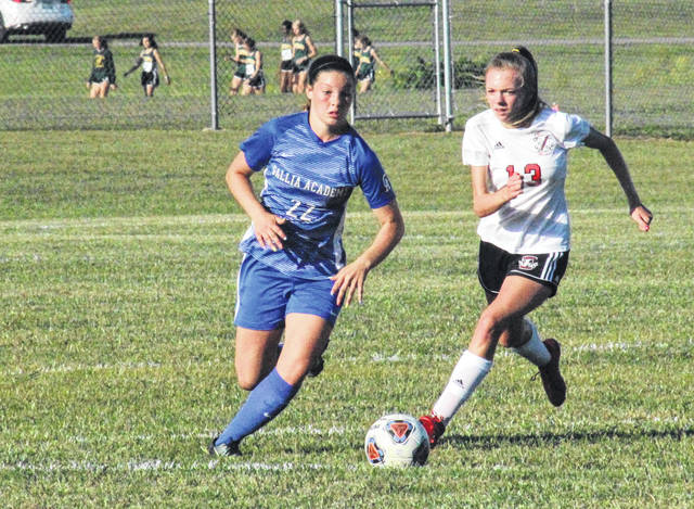 GAHS sophomore Preslee Reed (22) crosses midfield in front of PPHS sophomore Kady Hughes (13) during a non-conference match on Sept. 3 at Lester Field in Centenary, Ohio.